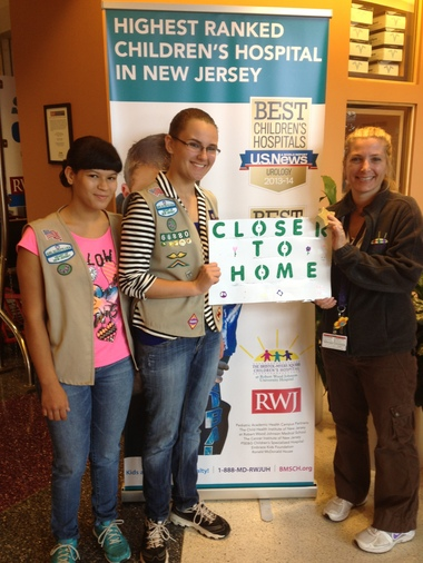 Girl Scouts Thalia Centolanza and Sydney Rosen with Peggy Travostino, Child Life Specialist at RWJUH